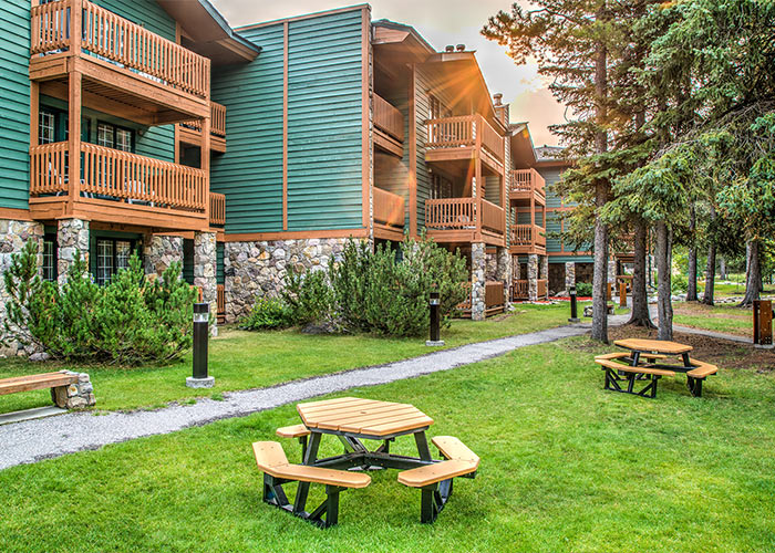 Picnic Table area outside of lodging with grassy area