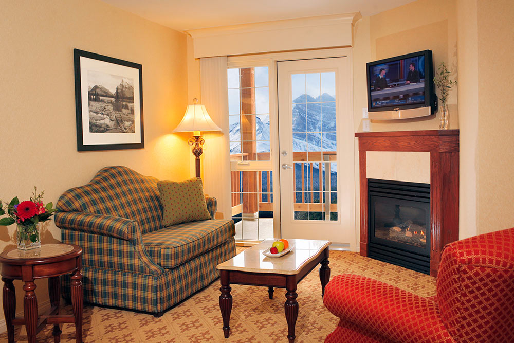 deluxe two bedroom suite with fireplace and mountain view