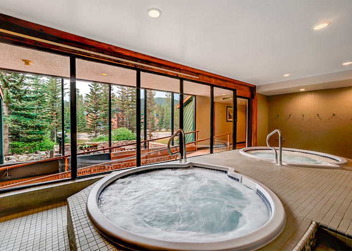 2 whirlpools with big windows looking out into nature