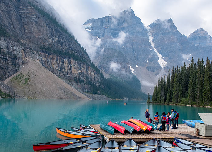 Collection of canoes on does for rent at Moraine Lake