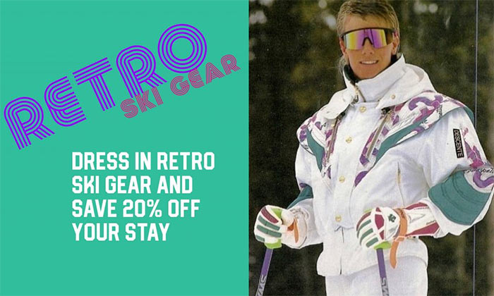Male skier sporting rayban mirrored sunglasses in one piece descente ski suit with padded shoulders